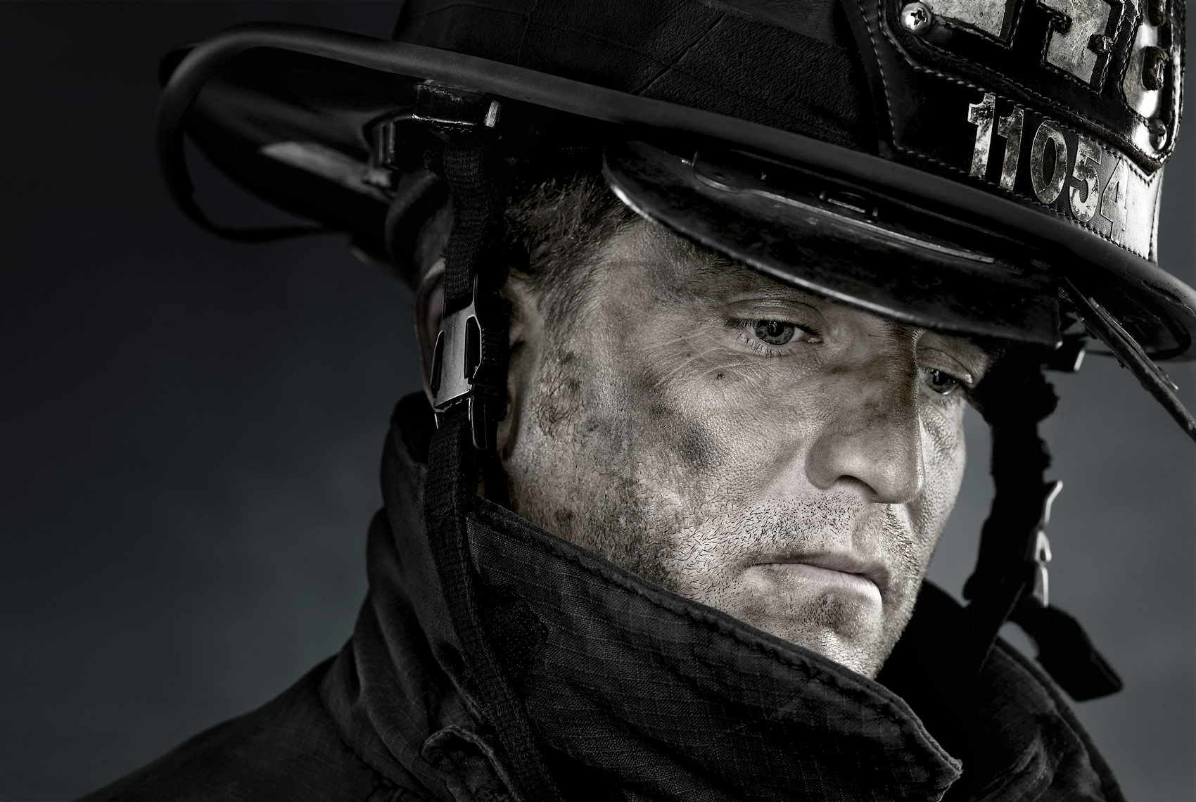 Portrait of a New York City firefighter with helmet